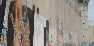 Ελεύθεροι οι Ιταλοί που ζωγράφισαν την Άχεντ Ταμίμι στο Τείχος της Δυτ. Όχθης