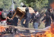 Δύο νεκροί και τουλάχιστον τρεις σοβαρά τραυματίες σε ταραχές στο Σαντιάγο